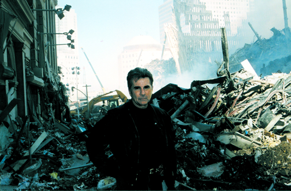 <em>Walsh at Ground Zero beginning the hunt for the September 11, 2001 terrorists on <strong>America's Most Wanted</strong>.</em>