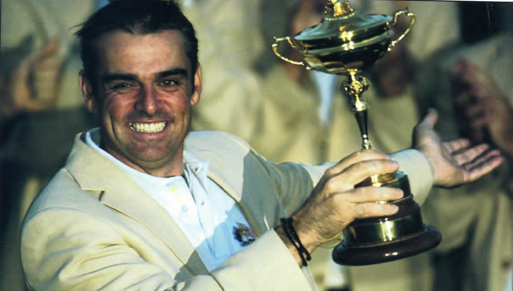 Paul McGinley holding the Ryder Cup.