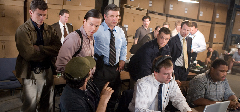 Center from left to right: Sergeant Dignam (MARK WAHLBERG), Captain Ellerby (ALEC BALDWIN) and Colin Sullivan (MATT DAMON) head up the surveillance team, including Brown (ANTHONY ANDERSON, seated far right), that is monitoring a meeting between Costelloâ's gang and the Chinese Triad in Warner Bros. Pictures crime drama The Departed.