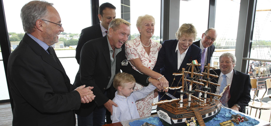 At the opening of the Dunbrody Emigration History Centre, the Flatley family cuts into a special Dunbrody cake with Editor-in-Chief Patricia Harty and the Dunbrody board.