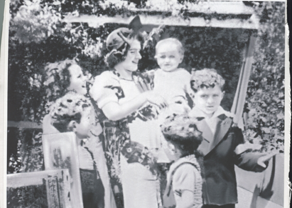 Mary Moriarty with six of her nine children. Left to right: Aileen, John, Dennis (held by Mary), Steve and Daniel.