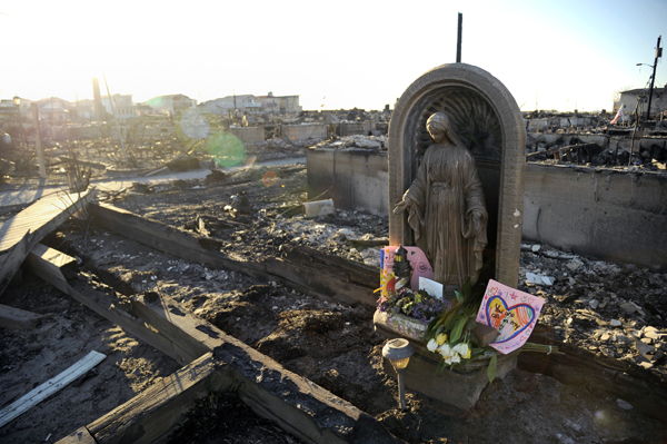 A Statue Of The Virgin Mary, Which Mary McNulty Placed In Her Garden Years  Ago, Stands Intact Amid The Ruins. Photo: Peter Foley.