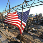 An American flag waves over Breezy Point. Photo: Peter Foley.