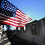 An American Flag waves over Breezy Point, Queens. Photo: Peter Foley.