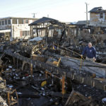 A resident of Breezy Point Queens looks over what was once his home. Photo: Peter Foley.