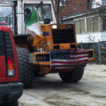 A bulldozer on Beach 91st Street shows its Irish American spirit. Photo: Sheila Langan.