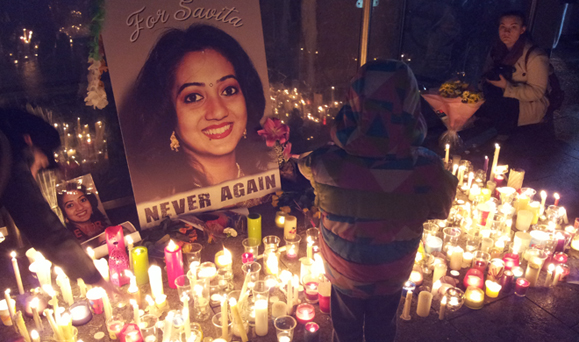 picture of savita, surrounded by candles, from vigil held in Ireland for Savita Halappanavar.