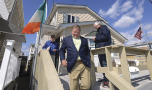 Brian Kelly, Football Coach for Notre Dame visits Breezy Point. In this photo, he brings joy to Jim McGuire, an 80-year-old resident. Photo: Peter Foley.