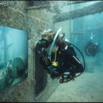 "Divers tour Andreas Franke's exhibition ""The Sinking World"" in the USS Vandenberg. Photo: Andreas Franke."