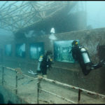 "Divers explore Andreas Franke's exhibition ""The Sinking World"" in the USS Vandenberg. Photo: Andreas Franke."