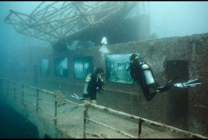 """Divers explore Andreas Franke's exhibition """"The Sinking World"""" in the USS Vandenberg. Photo: Andreas Franke."""