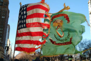 The U.S. flag and the flag of the Irish brigade fly together. Photo courtesy of the 69th NYSV Historical Association