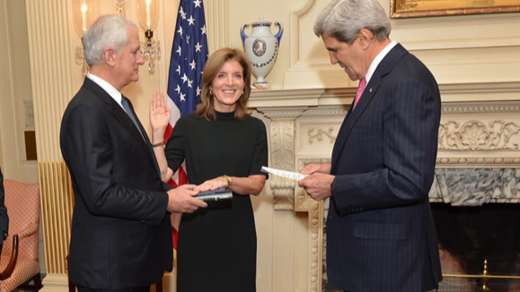 Caroline Kennedy is sworn in as Ambassador to Japan by Secretary of State John Kerry. Her husband, Edwin Schlossberg, holds the Bible.