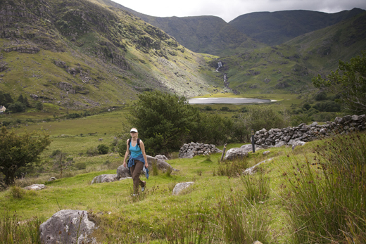 Hiker on the Kerry Way in McGillycuddy Reeks, Black Valley, County Kerry.