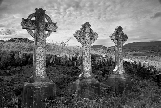 Celtic cross tombstones at a church graveyard on Abbey Island, County Kerry.