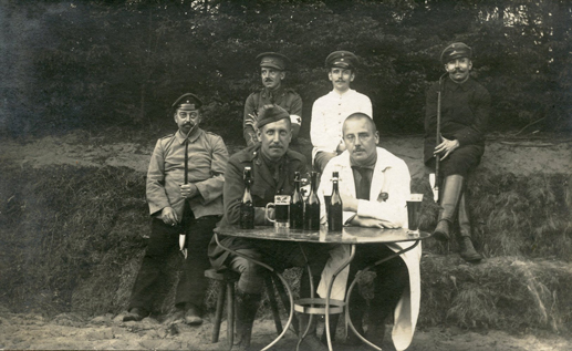 Major Egan, at table (left). Senneglager Prisoner of War Camp, 1915.