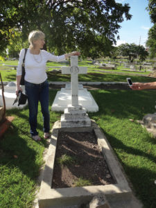Patricia Harty at William Egan's grave in Jamaica. September, 2013.