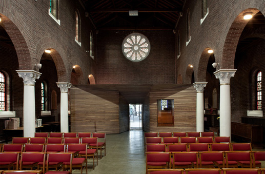 Interior of nave,  St Thomas's, Cathal Brugha Street, Dublin, Frederick Hicks 1932, with a 21st-century insertion by Clancy Moore Architects. Image © Paul Tierney.