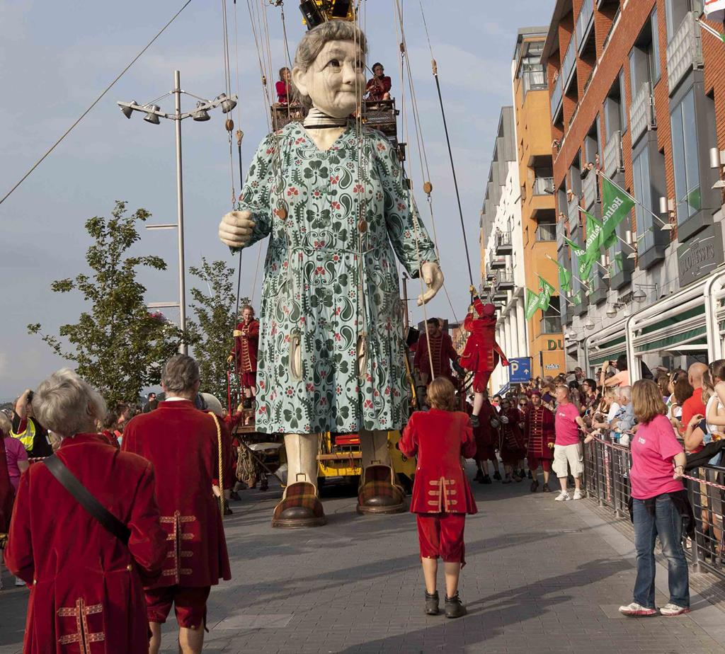"""Granny,"" a project by the French marionette group Royale de Luxe, walks down the quay in Limerick early September."