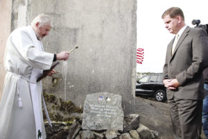 TOP: Martin J. Walsh, Mayor of Boston unveils the Foundation Stone for the Emigrants Commemorative Center in Carna in Connemara in September.Project chairperson, Máirtin Ó Catháin (left) with the mayor. Mayor Walsh's late father, John Walsh was a native of Carna and his mother Mary is a native of the neighboring parish of Ros Muc.Both parishes are in the Gaeltacht – the Irish speaking area of Ireland. CENTER: Local parish priest, Fr. Padraig Standún blesses the Foundation Stone as Mayor Walsh of Boston looks on. BOTTOM: Former Taoiseach Liam Cosgrave greets Mayor Walsh of Boston at the Emigrants Commemorative Center Foundation ceremony.Mr. Cosgrave went to primary school for a term in the old school building on the site in 1930.Now 94, Mr. Cosgrave travelled from Dublin for the occasion.