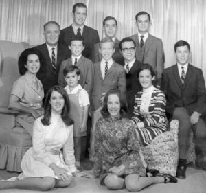 Young Stephen  (in jumper) with his  parents and ten older  siblings, 1968.