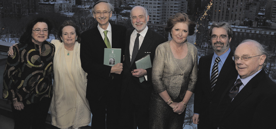 Judith McGuire, president of the GIH board; GIH founder, and co-chair of the dinner, Loretta Brennan Glucskman; honorees Ted Smyth and Peter Quinn; dinner co-chair Mary Shanahan; the author Terry Golway who acted as M.C.; and Joe Lee, director of Glucksman Ireland House. (Photo: James Higgins © 2015)