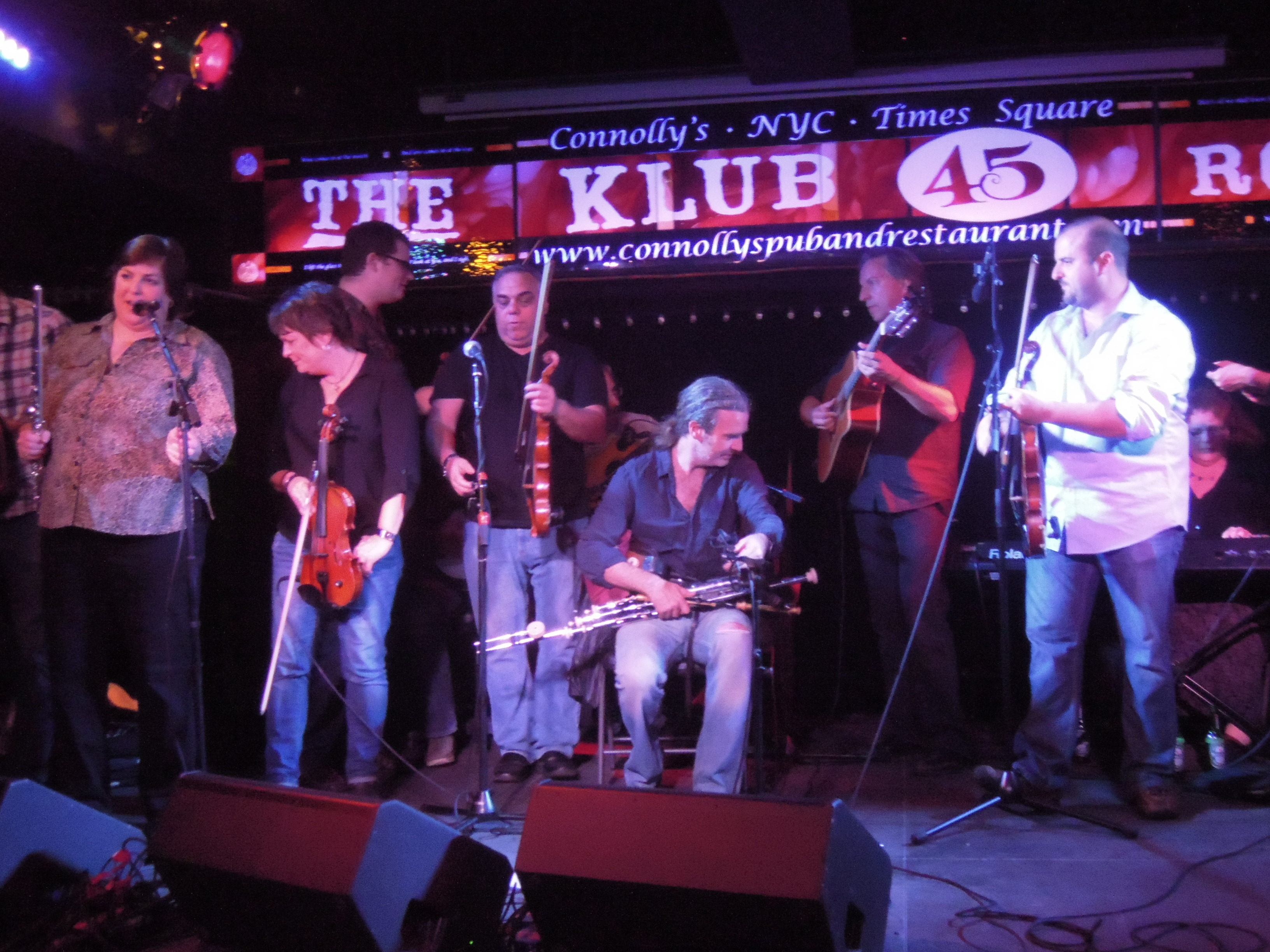 Joanie and a gang of musicians, including  virtuoso fiddle-player Eileen Ivers, at the first New York Trad Fest.