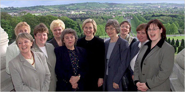 Then-First Lady Hillary Clinton and Northern Ireland legislators, members of DemocraShe, a post-GFA women's rights  organization aimed at promoting female  legislators in Northern Ireland.