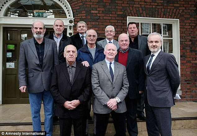 Victims: Colm O'Gorman, executive director of Amnesty International Ireland, (front right) with a number of the surviving victims. They became known as the 'Hooded Men' after revealing details of their treatment. (Photo: Daily Mail)