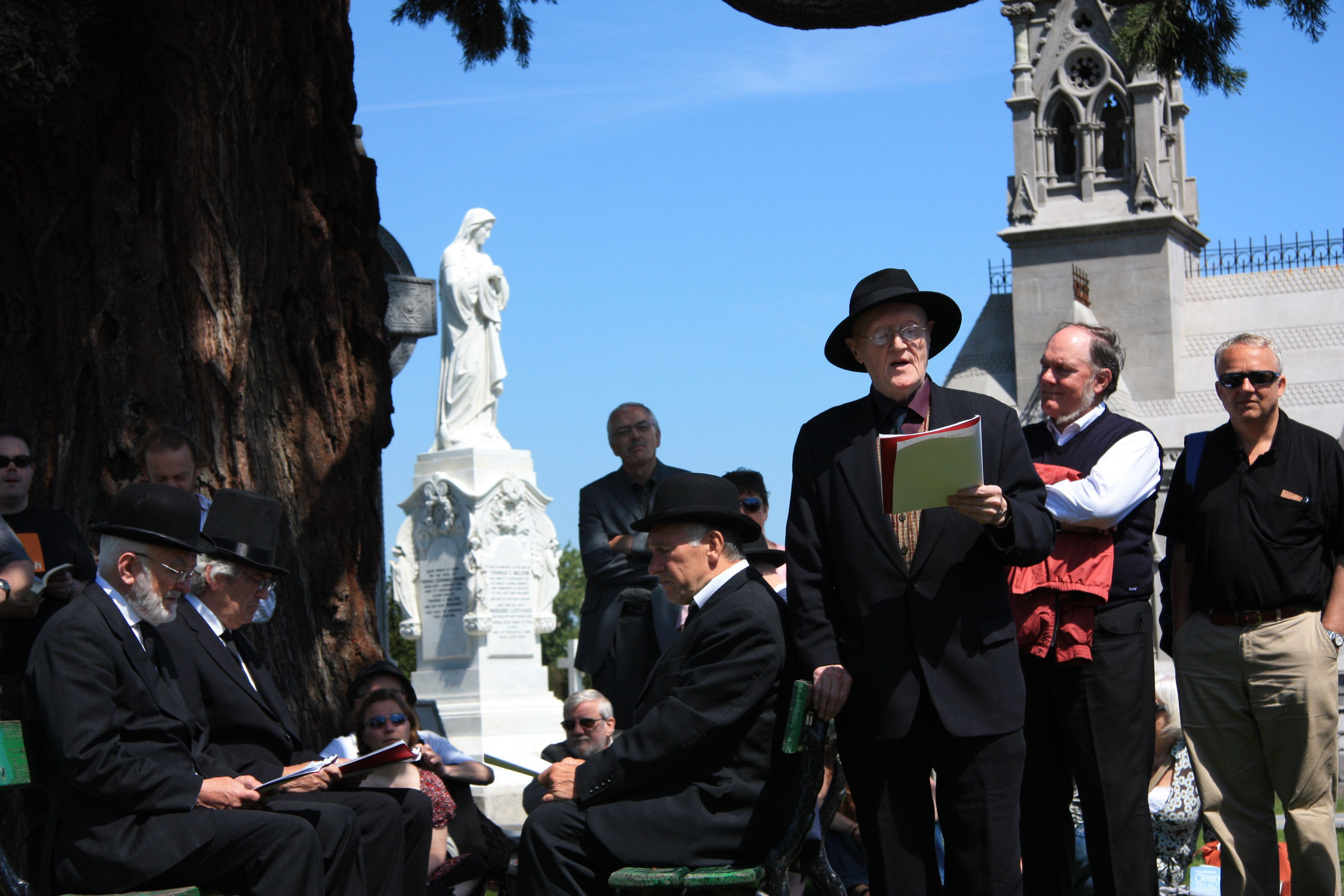 Reading Ulysses at  Glasnevin on the James Joyce Bloomsday tour.