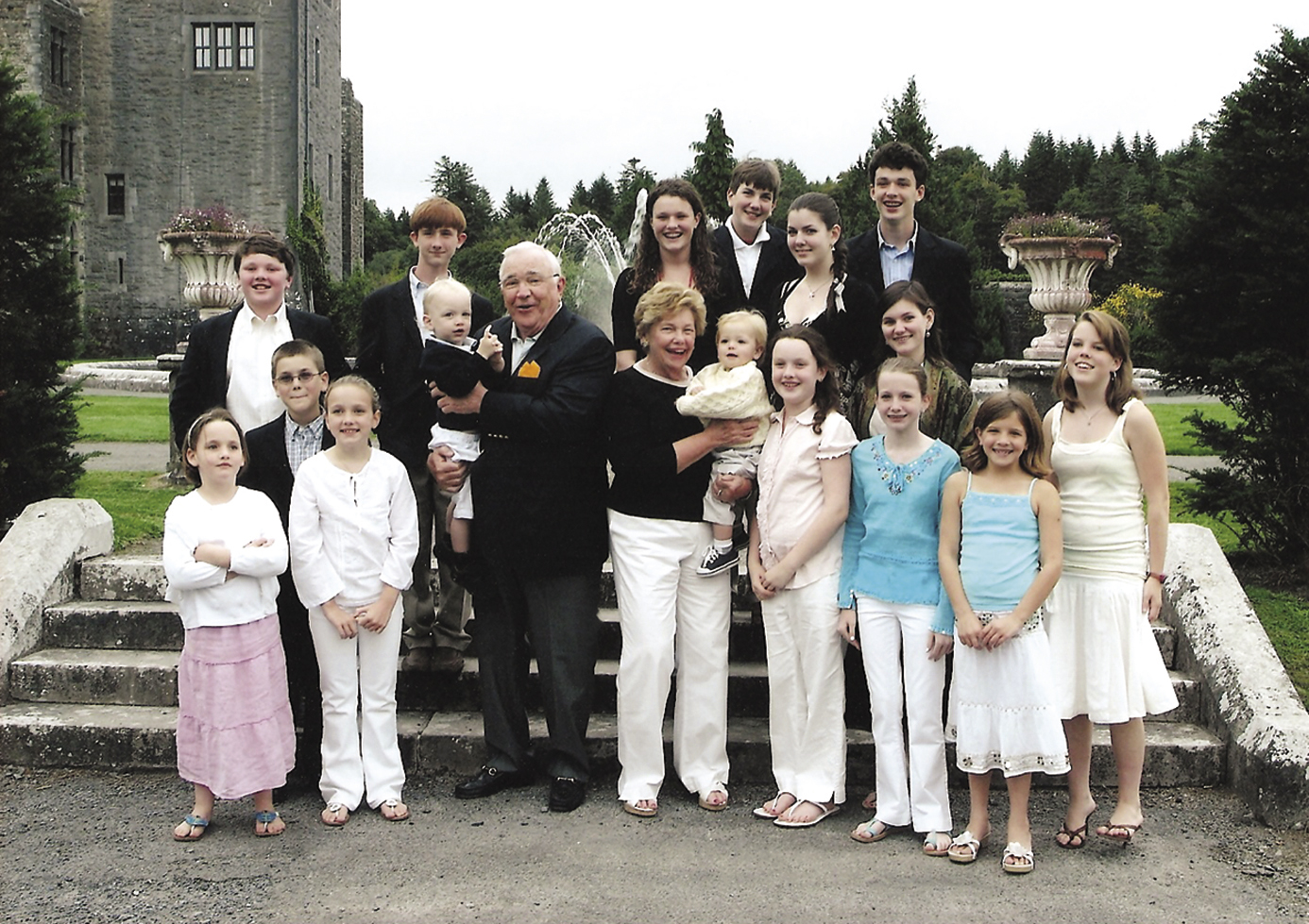 Don and his wife Mickie (center with babies) at Ashford Castle in 2006 with 16 of their 18  grandchildren (two could not make the trip because of school). (Photo courtesy Keough family).