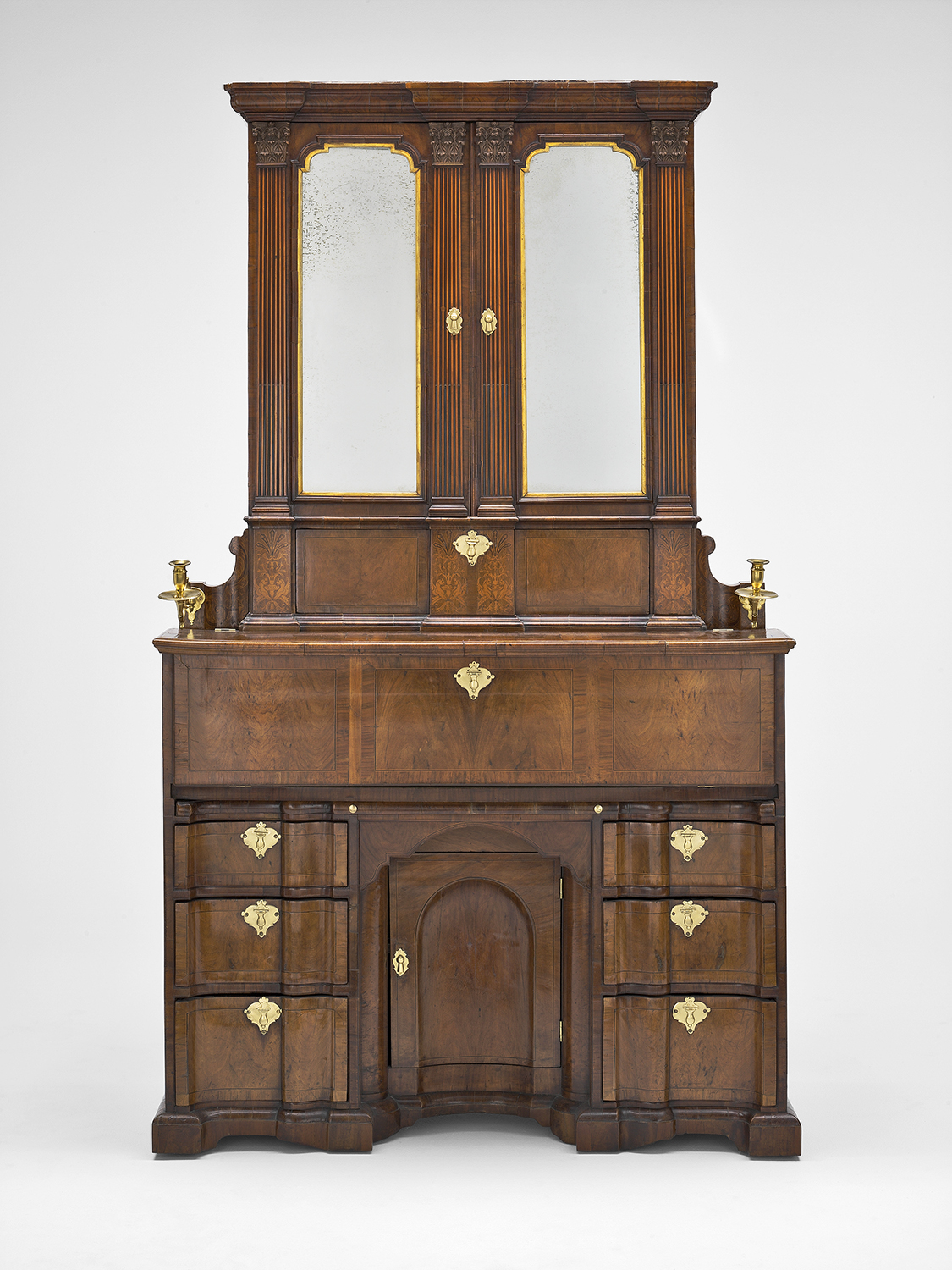 John Kirkhoffer Walnut  Secretary Cabinet, 1732. 18th-century Dublin was a booming city, attracting furniture makers and customers from England and the rest of Europe. The Kirkhoffer families were German Protestants who had fled to Ireland to escape religious persecution.  Jonathan Swift, author of Gulliver's Travels, is said to have owned one of these cabinets. Art  Institute of Chicago.
