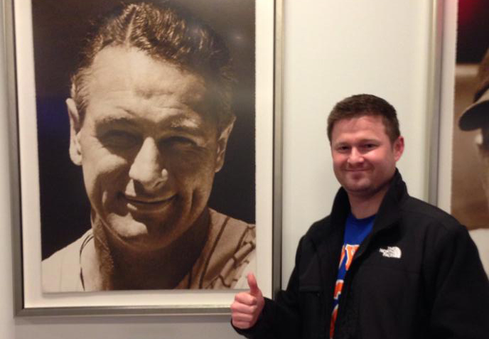Pat with a photograph of Lou Gehrig. (Photo: Facebook / Quinn 4 the Win)