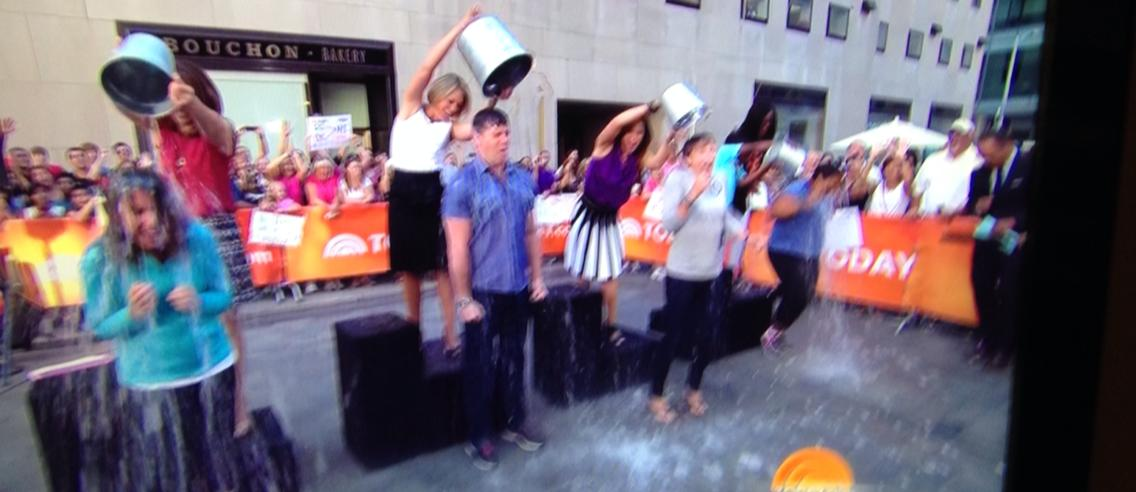 Katie Couric (center) doing the Challenge with the Today Show at Rockefeller Center, August 10, 2014.