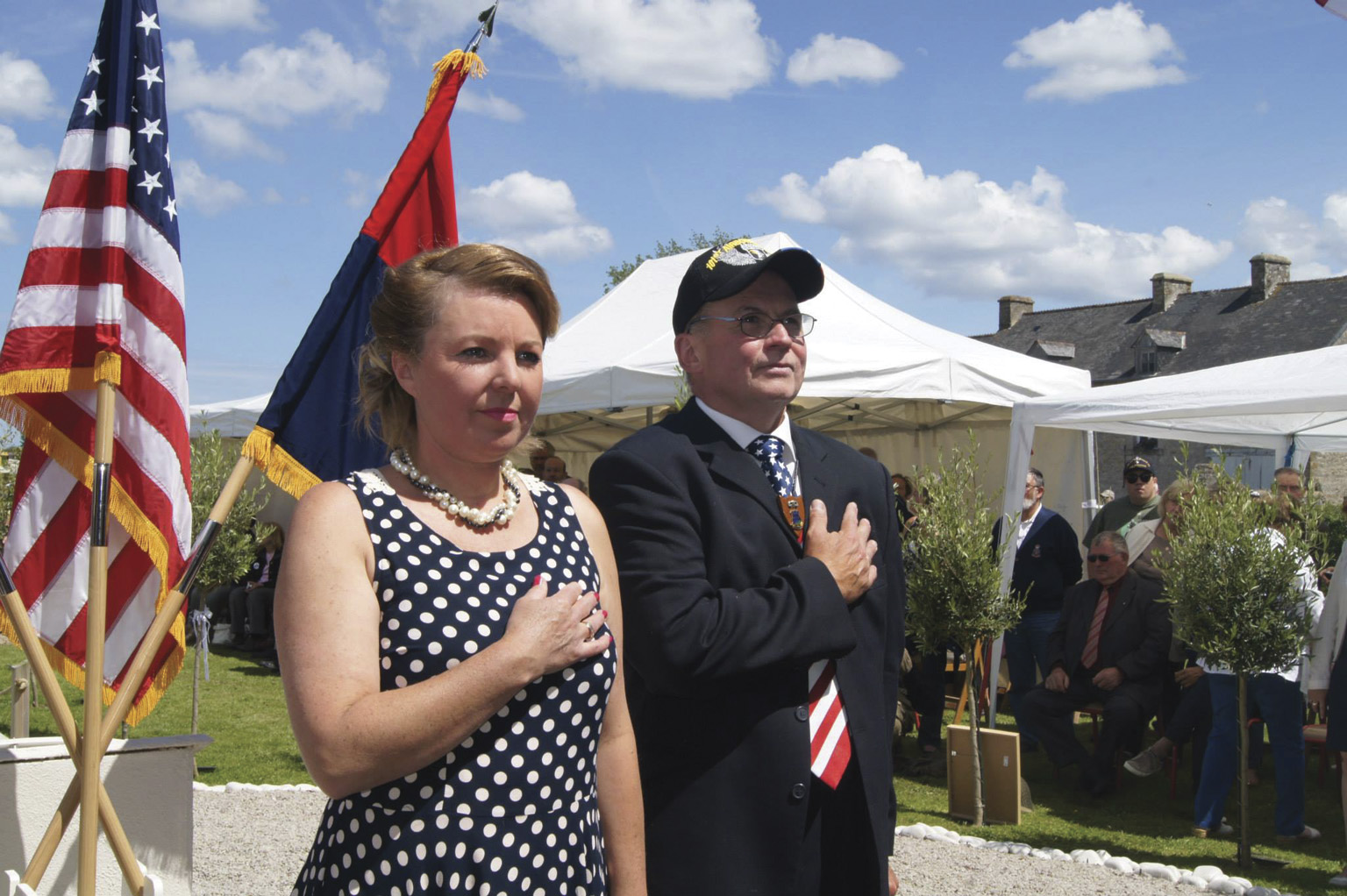 David Ashe and his partner, Céline Schwab Lautour, organize the annual ceremony at the Ravenoville Eternal Heroes Memorial. Ashe, the founder of the monument, believes in peace and reconciliation and flies both the U.S. and German flags.
