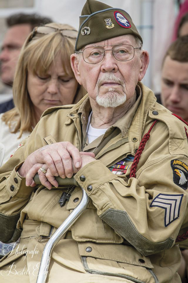 Donald Burgett, one of Ravenoville's liberators, watches the 2014 commemoration events at the Memorial.