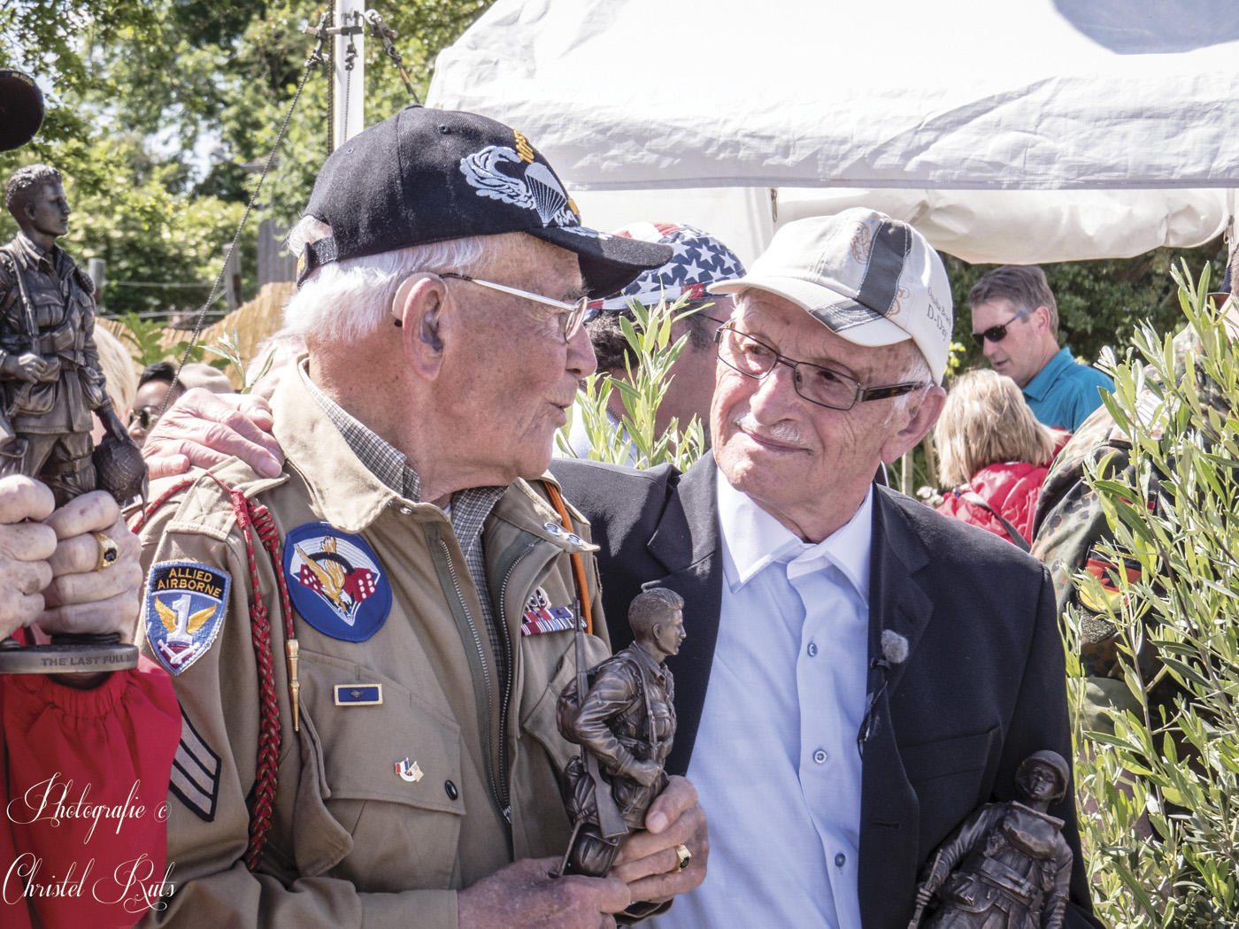 "Former ""Screaming Eagle"" Robert Noody (left) chats with one-time adversary Kurt Keller, a German veteran."