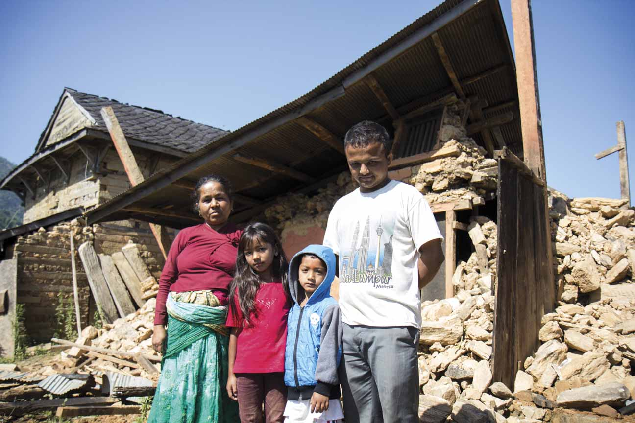 Kamala Neupane, 54, Ayushma Singh, eight, Ayush Singh, five, and Pratap Neupane, 23.  Kamala Neupane lived in the home and was in Bakrang when the earthquake hit. Her husband passed away years ago and her children all live outside of Bakrang, so she spent the hours after the earthquake trying to reach her children. her son, Pratap, is student in Kathmandu and came back to Bakrang to help his mother recover what they can from the rubble.