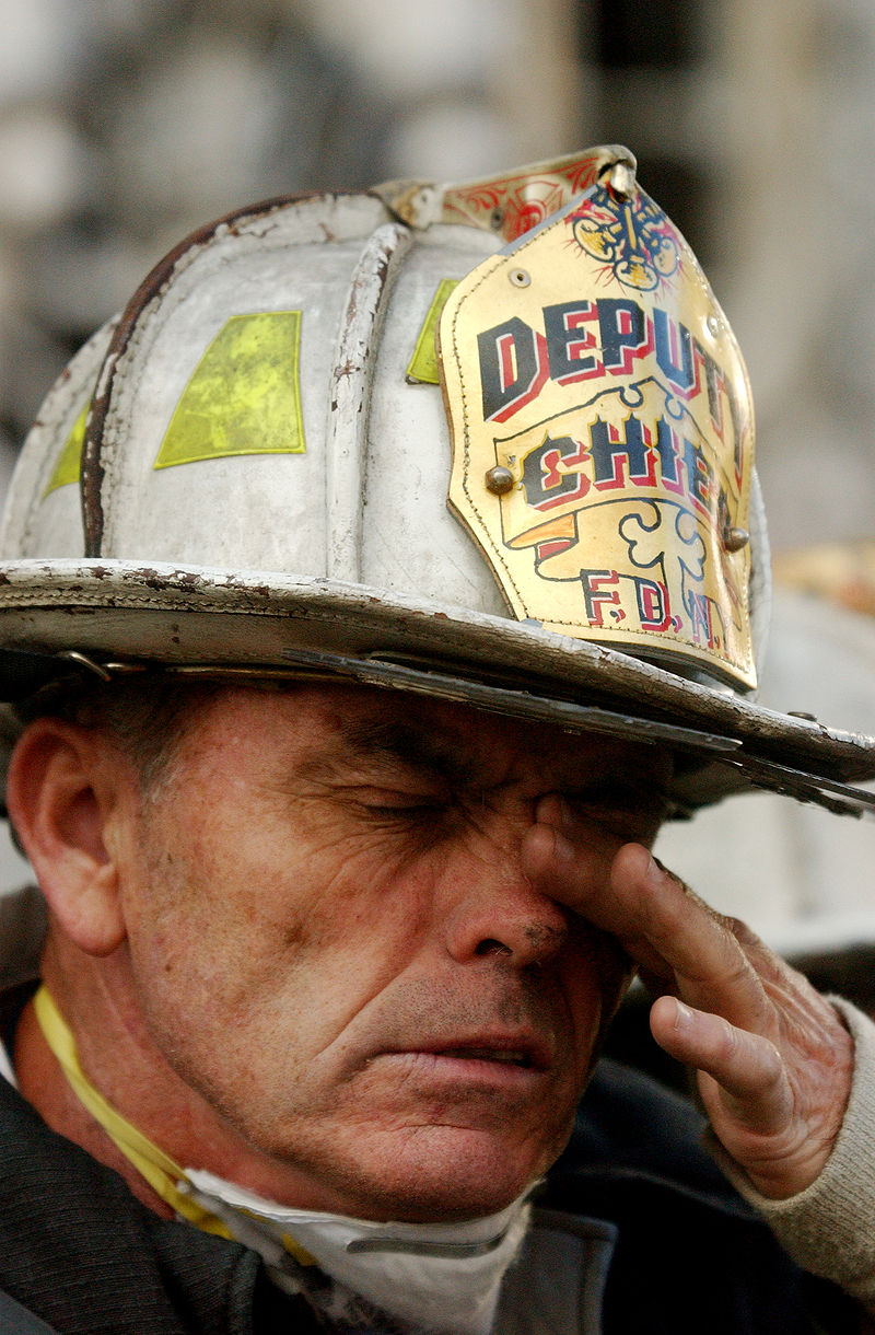 9/14/2001 – A New York City firefighter attempts to clear his eyes of soot during rescue efforts at the World Trade Center following the September 11, 2001, terrorist  attack.
