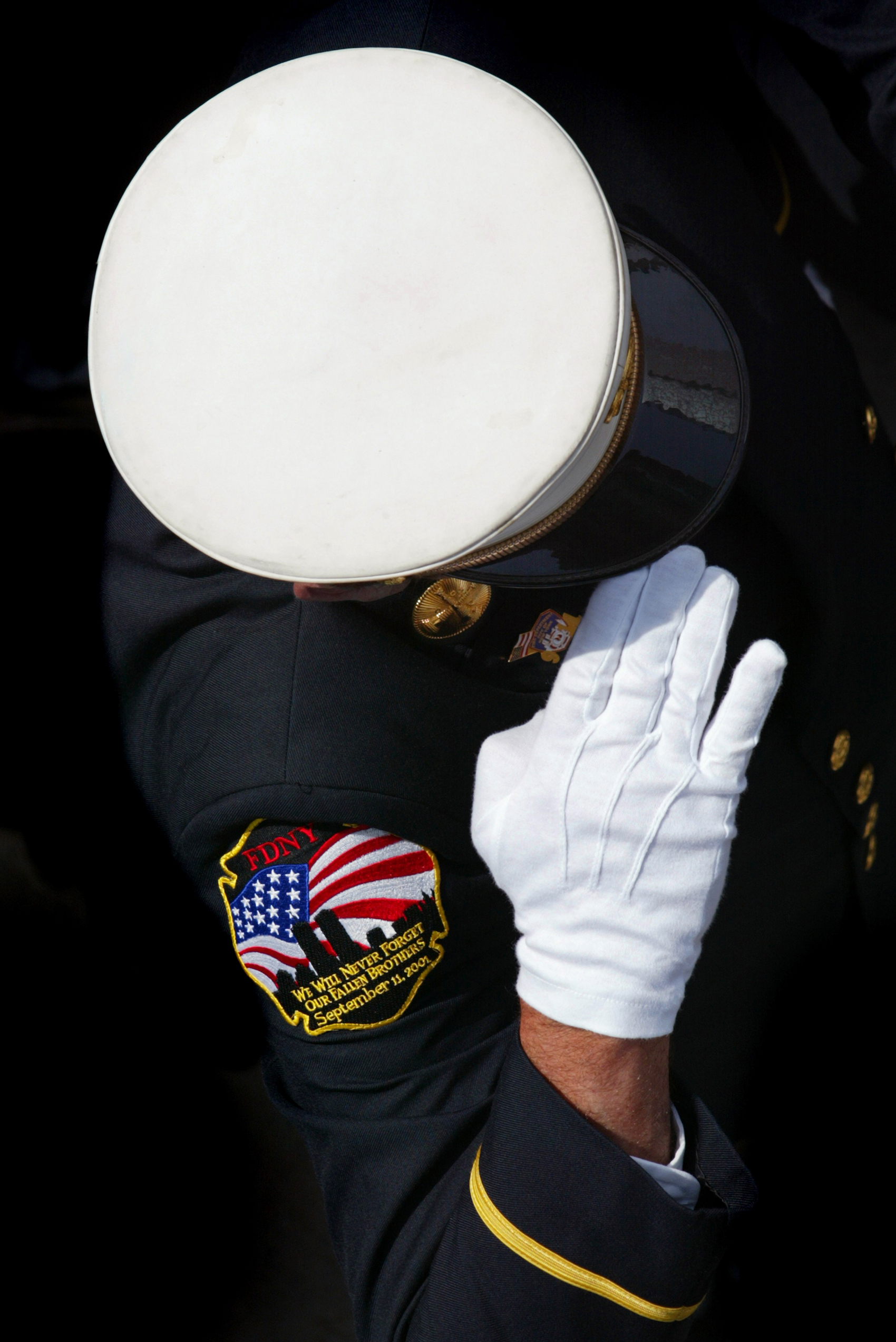 A final salute for a fallen comrade. 343 firefighters were killed in the rescue attempts following the terrorist attack on 9/11. Scores more are suffering from ailments linked to the clean-up efforts.