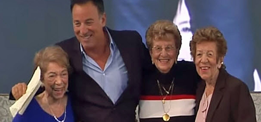 Bruce Springsteen with his mother (with the gold medallion) and aunts at Ellis Island.