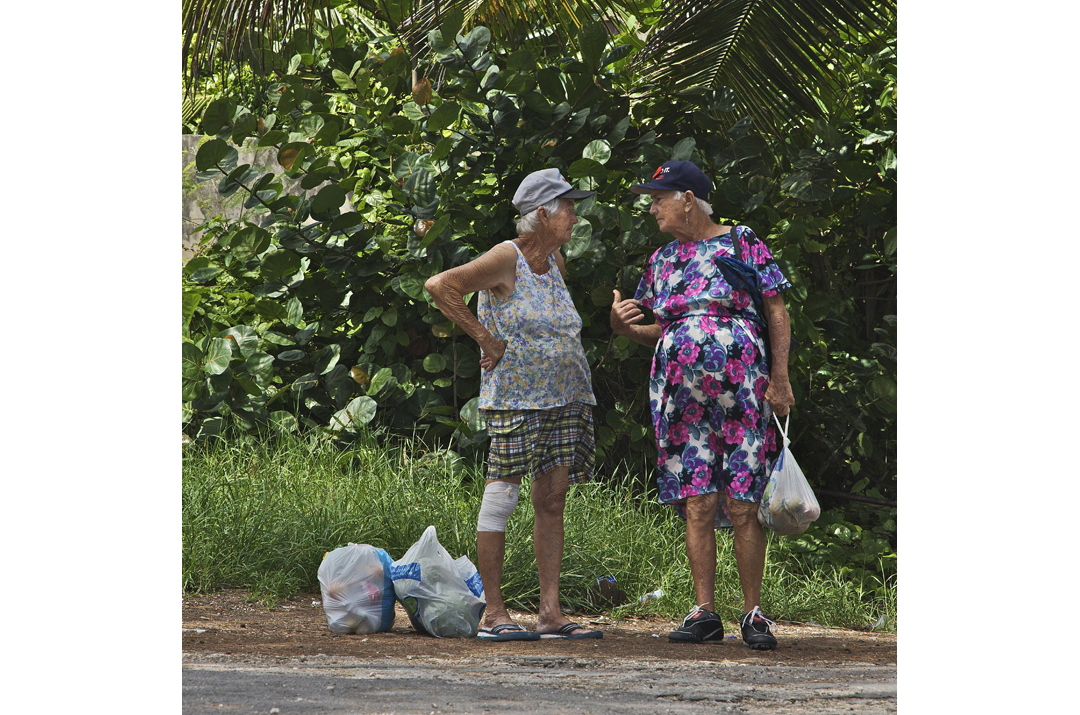 Village Gossip: Two of Erlene Downie's sisters stop for a chat.