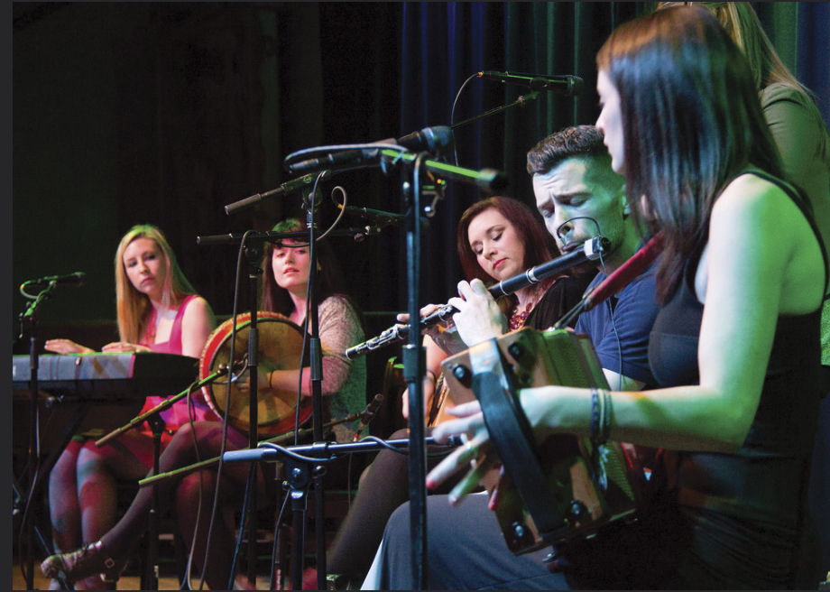 Girsa on stage: Emily McShane, Bernadette Flanagan, Pamela  Geraghty, flute player Sean Tierney, the newest member of the group, and Blaithin Loughran.