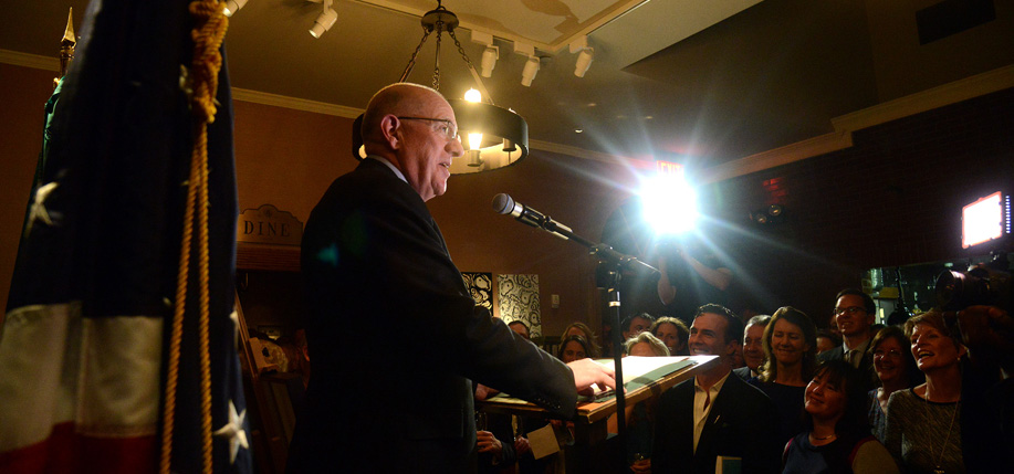 Foreign Minister Charlie Flanagan addresses the large gathering at Pier A. Jan. 7, 2016. Photo: James Higgins