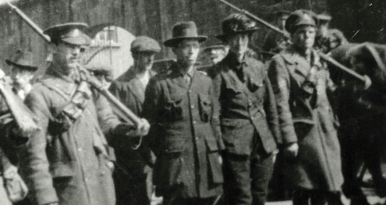 Markievicz is escorted by British troops following the surrender of the College of Surgeons in 1916.