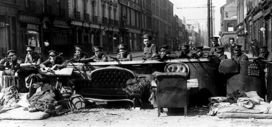 Manning the barricades: Archive image of a barricade across Talbot Street, Dublin, manned by British soldiers in an effot to quell the insurrection of Irish nationalists during the Easter Rising of 1916. Credit - CAMERA PRESS/ILN.