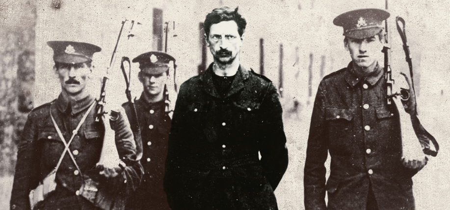 De Valera under arrest by British troops  following the Rising.
