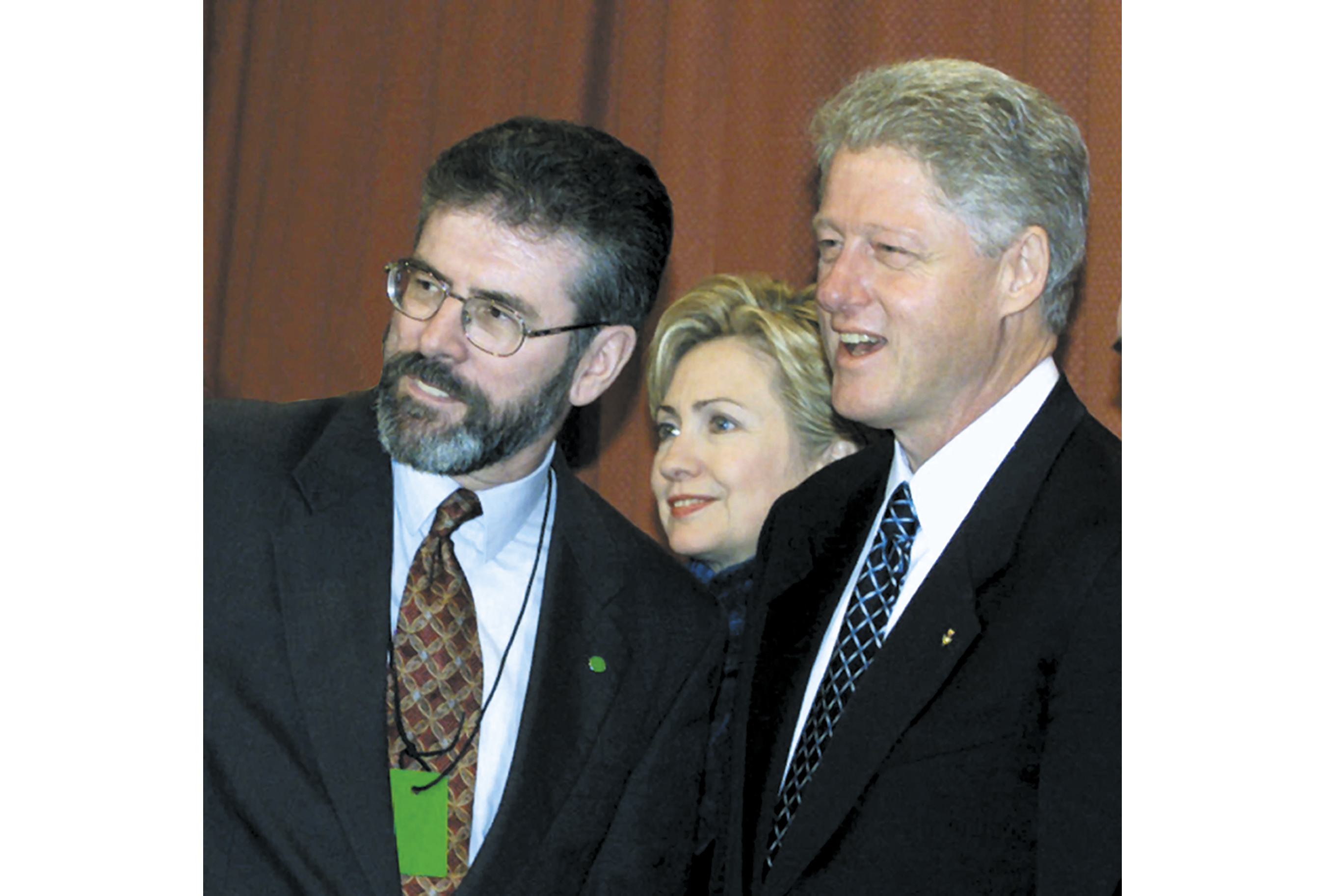 President Clinton and Irish Prime Minister Bertie Ahern, right, talk with Gerry Adams, president of Sinn Fein, left, at a reception at the Guinness brewery in Dublin. Clinton is on the first day of a three-day visit. First lady Hillary Rodham Clinton is standing in the background. (AP Photo/Ron Edmonds)