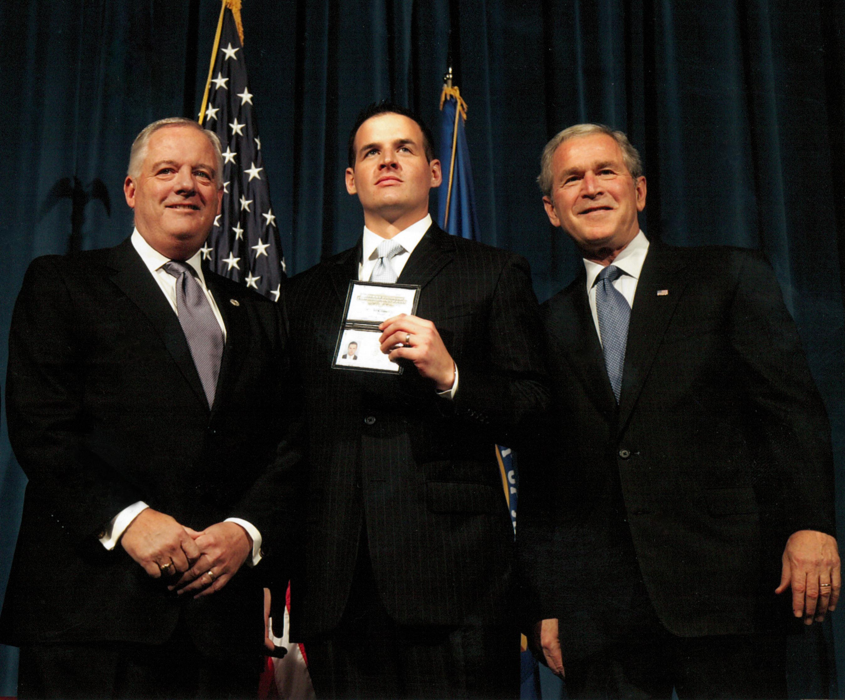 Kenney and son Brendan with President George W. Bush on the occasion of Brendan's induction into the FBI.
