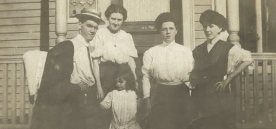 Julia Frances Rohan (née Fraher), far right in the hat, pictured with her family outside her home in Boston.